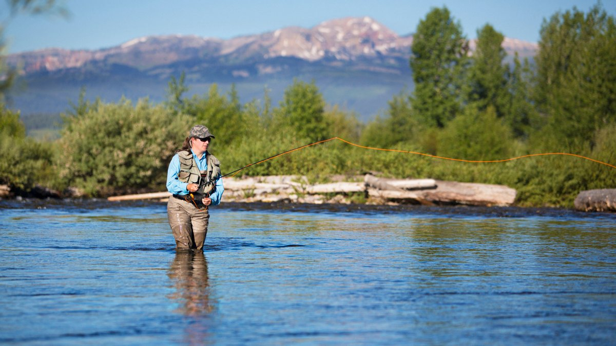 woman-wading-shallow-fly-fishing